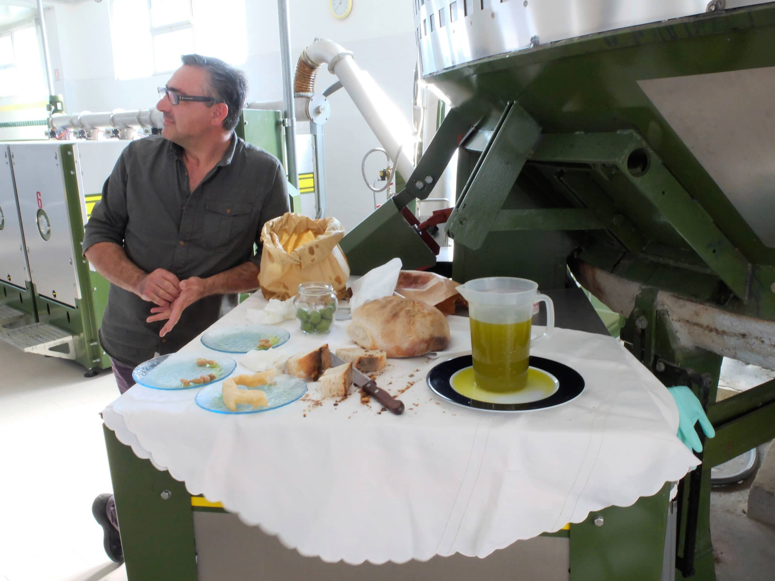Nothing beats fresh olive oil with fresh bread, being shared here with mill owner Piero Rovitti.