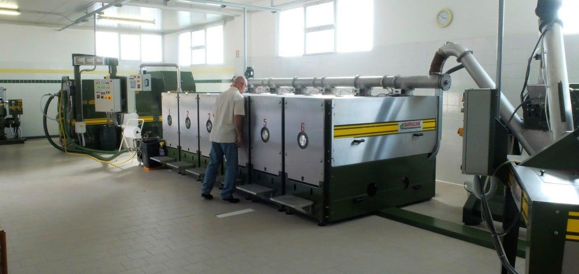 Orazio inspecting the machinery at the Rovitti mill.