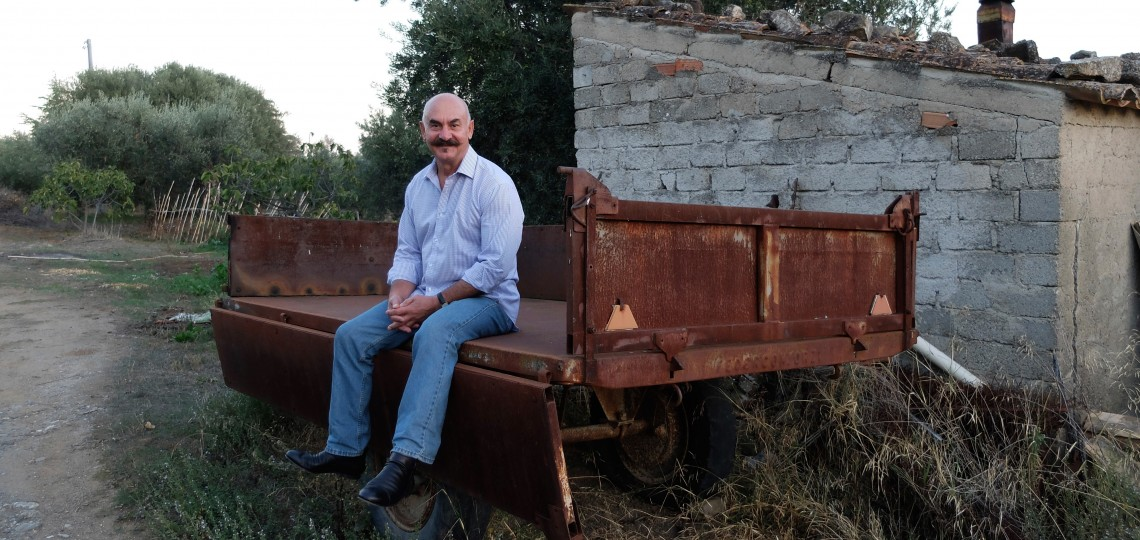 Orazio sitting on the actual cart that he would ride to school, pulled by an old tractor.