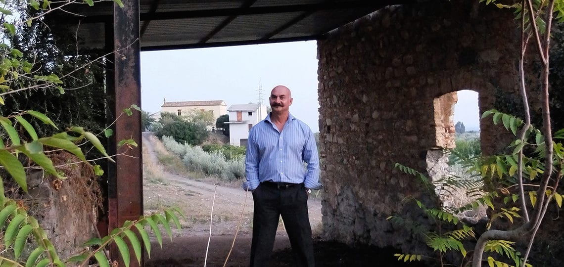Orazio standing in the interior what was once his elementary school.